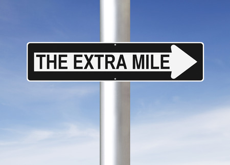 A modified one way sign indicating The Extra Mile