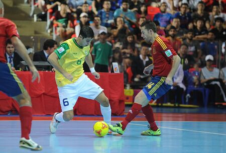 BANGKOK, THAILAND - NOV 18   Unidentified players in FIFA Futsal World Cup thailand 2012 Between Spain  R  VS Brasil  Y  on November 18, 2012 at Indoor Stadium Huamark in Bangkok Thailand   Stock Photo - 16425279