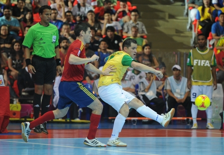 BANGKOK, THAILAND - NOV 18   Unidentified players in FIFA Futsal World Cup thailand 2012 Between Spain  R  VS Brasil  Y  on November 18, 2012 at Indoor Stadium Huamark in Bangkok Thailand
