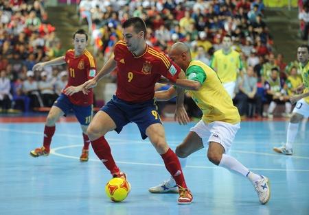 BANGKOK, THAILAND - NOV 18   Unidentified players in FIFA Futsal World Cup thailand 2012 Between Spain  R  VS Brasil  Y  on November 18, 2012 at Indoor Stadium Huamark in Bangkok Thailand   Stock Photo - 16425283