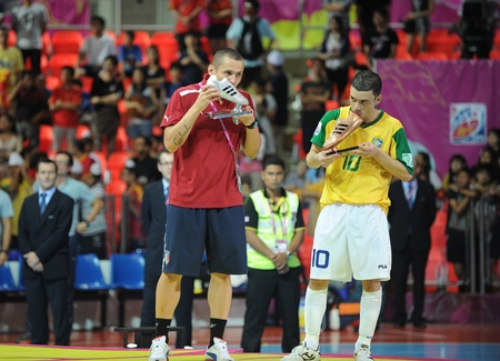 BANGKOK, THAIALND - NOV 18  Fortino  R  of Italy and Fernandinho  Y  of Brazil ,won the Adidas Silver Shoes and Adidas Golden Shoes in FIFA Futsal World Cup Thailand 2012 on November 18,2012 at Indoor Stadium Huamark in Bangkok Thailand   Stock Photo - 16425285