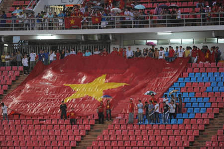 BANGKOK THAILAND-NOV 24   Unidentified of Vietnam Flag supporters during the AFF Suzuki Cup between Vietnam and Myanmar at Rajamangala stadium on Nov24, 2012 in Bangkok,Thailand