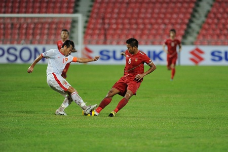 BANGKOK, THAILAND-NOV 24  Kyi Lin of Myenmar  r  in action during the AFF Suzuki Cup between Vietnam and Myanmar at Rajamangala stadium on Nov24, 2012 in Bangkok,Thailand