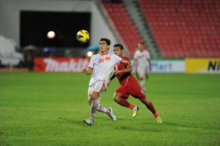 BANGKOK, THAILAND-NOV 24   Nguyen Gia Tu of Vietnam  w   in action during the AFF Suzuki Cup between Vietnam and Myanmar at Rajamangala stadium on Nov24, 2012 in Bangkok,Thailand