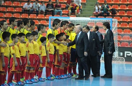 BANGKOK, THAILAND - NOV 18  FIFA President Joseph S  Blatter is seen with player of Colombia prior to the FIFA Futsal World Cup 3rd place at Indoor Stadium Huamark on November 18, 2012 in Bangkok, Thailand  Stock Photo - 16585917