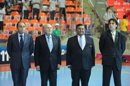 BANGKOK, THAILAND - NOV 18  FIFA President Joseph S  Blatter stand for the National Anthem prior to the FIFA Futsal World Cup 3rd place between Italy and Colombia at Indoor Stadium Huamark on November 18, 2012 in Bangkok, Thailand  Stock Photo - 16585916
