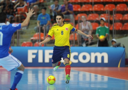 BANGKOK, THAILAND-NOV 18  Jorge Abril of Colombia  y  runs with the ball during the FIFA Futsal World Cup between Italy and Colombia at Indoor Stadium Huamark on Nov18,2012 in Bangkok,Thailand