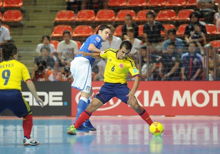 BANGKOK, THAILAND-NOV 18   Miguel Sierra of Colombia  y  in action during the FIFA Futsal World Cup between Italy and Colombia at Indoor Stadium Huamark on Nov18,2012 in Bangkok,Thailand