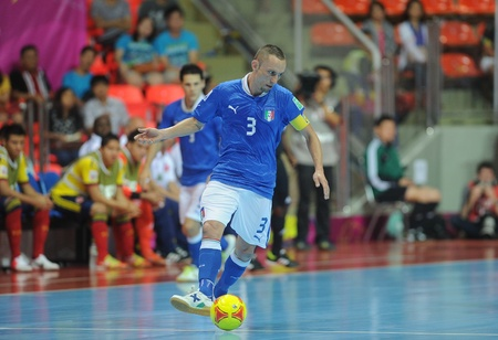 BANGKOK, THAILAND-NOV 18  Marcio Forte of Italy  b  runs with the ball during the FIFA Futsal World Cup between Italy and Colombia at Indoor Stadium Huamark on Nov18,2012 in Bangkok,Thailand