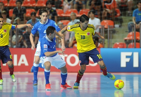 BANGKOK, THAILAND-NOV 18 Angellott Caro of Colombia  y  in action during the FIFA Futsal World Cup between Italy and Colombia at Indoor Stadium Huamark on Nov18,2012 in Bangkok,Thailand