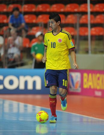 BANGKOK, THAILAND-NOV 18  Angellote Caro of Colombia  y  runs with the ball during the FIFA Futsal World Cup between Italy and Colombia at Indoor Stadium Huamark on Nov18,2012 in Bangkok,Thailand  Stock Photo - 16586059