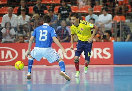BANGKOK, THAILAND-NOV 18 Yeisson Fonegra of Colombia  y  in action during the FIFA Futsal World Cup between Italy and Colombia at Indoor Stadium Huamark on Nov18,2012 in Bangkok,Thailand  Stock Photo - 16586061