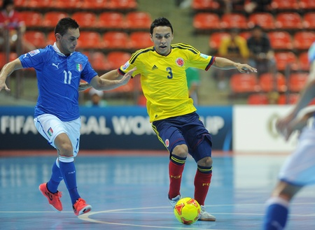 BANGKOK, THAILAND-NOV 18 Luis Barreneche of Colombia  y  in action during the FIFA Futsal World Cup between Italy and Colombia at Indoor Stadium Huamark on Nov18,2012 in Bangkok,Thailand  Editorial