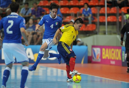 BANGKOK, THAILAND-NOV 18 Andres Reyes of Colombia  y  in action during the FIFA Futsal World Cup between Italy and Colombia at Indoor Stadium Huamark on Nov18,2012 in Bangkok,Thailand
