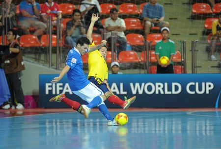 BANGKOK, THAILAND-NOV 18 Alex Merlim of Italy  b  in action during the FIFA Futsal World Cup between Italy and Colombia at Indoor Stadium Huamark on Nov18,2012 in Bangkok,Thailand