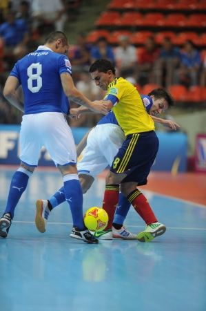 BANGKOK, THAILAND-NOV 18 Jorge Abril of Colombia  y  in action during the FIFA Futsal World Cup between Italy and Colombia at Indoor Stadium Huamark on Nov18,2012 in Bangkok,Thailand
