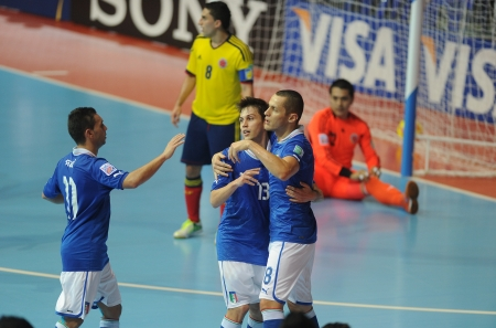 BANGKOK, THAILAND - NOV 18  Italy team celebrates after scoring during the FIFA Futsal World Cup the third place between Italy and Colombia at Indoor Stadium Huamark on Nov 18,2012 in Bangkok, Thailand