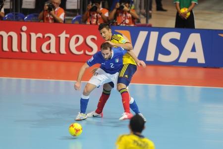 BANGKOK, THAILAND-NOV 18 Marco Ercolessi of Italy  b  in action during the FIFA Futsal World Cup between Italy and Colombia at Indoor Stadium Huamark on Nov18,2012 in Bangkok,Thailand  Stock Photo - 16586060