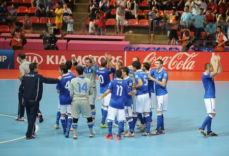 BANGKOK, THAILAND-NOV 18 Italy team celebrates after defeating Colombia during the FIFA Futsal World Cup the third place between Italy and Colombia at Indoor Stadium Huamark on Nov18,2012 in Bangkok,Thailand