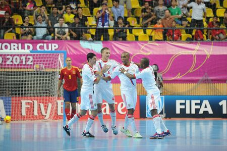 BANGKOK,THAILAND-NOV 14 Russia celebrates after scoring during the FIFA Futsal World Cup Quarterfinal round between Spain and Russia at Nimibutr Stadium on Nov14, 2012 in Thailand