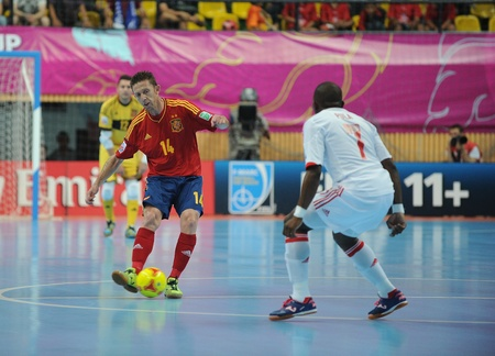 BANGKOK, THAILAND - NOV 14 Alemao of Spain  r  in action during the FIFA Futsal World Cup Quarterfinal round between Spain and Russia at Nimibutr Stadium on Nov 14,2012 in Bangkok, Thailand  Editorial