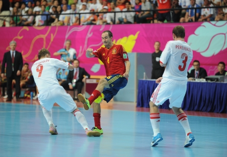 BANGKOK, THAILAND - NOV 14 Alvaro of Spain  r  in action during the FIFA Futsal World Cup Quarterfinal round between Spain and Russia at Nimibutr Stadium on Nov 14,2012 in Bangkok, Thailand