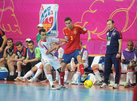 BANGKOK, THAILAND - NOV 14 Alcardo of Spain  r  in action during the FIFA Futsal World Cup Quarterfinal round between Spain and Russia at Nimibutr Stadium on Nov 14,2012 in Bangkok, Thailand  Editorial