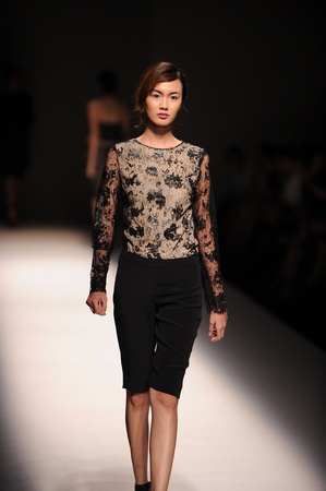 BANGKOK, THAILAND - OCT 12   Model walks the runway at  VATIT ITTHI   collection presentation during ELLE Fashion Week 2012 on October 12, 2012 in Bangkok Thailand  Editorial