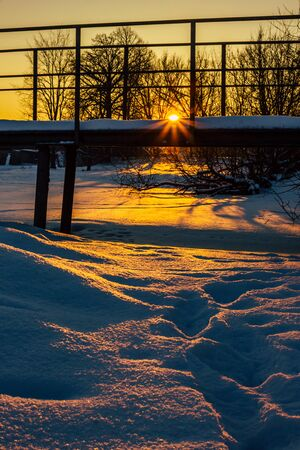 Snowy Bridge in a Countryside with the Sun Rays Gloving over it Directly into the Camera - Creating Sun Star