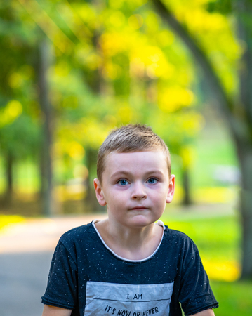 Kid Walking in Park in Autum Colorful Background - Caption on Shirt