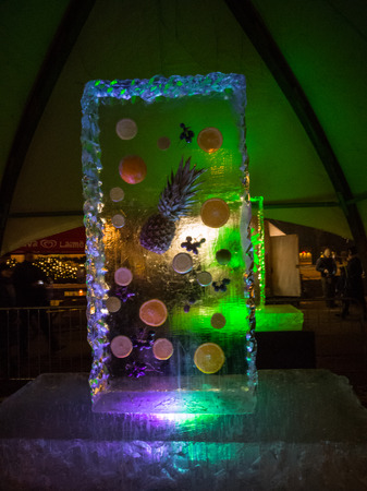 Jelgava / Latvia - February 10th, 2017: Colourfullighted fruits melted in ice  sculpture at night of International Ice Sculpture Festival in Jelgava. Éditoriale