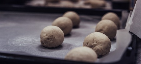 Small Bread Dough Balls Placed on Cooking Paper on Pan - Ready to be Baked, Kitchen Set, Vintage Film Look