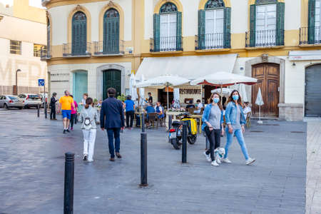 Malaga / Spain - May 18th, 2020: Cafes reopen business for clients, coronavirus, phase one