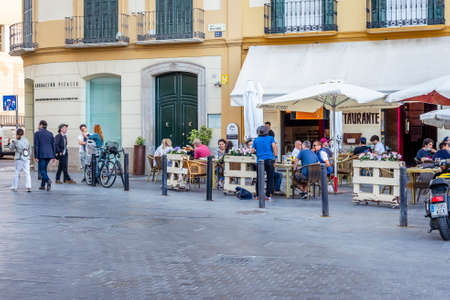 Malaga / Spain - May 18th, 2020: Cafes reopen business for clients, coronavirus, phase one Editorial