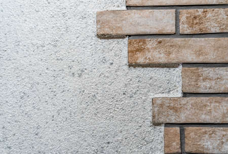 Tiles on Wall like Bricks, Background Texture Pattern with Copy Space - Concept of Renovation and Repairs