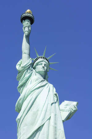 verticals: Statue of Liberty in New York set against a clear blue sky