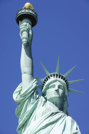 travelled: Statue of Liberty in New York set against a clear blue sky