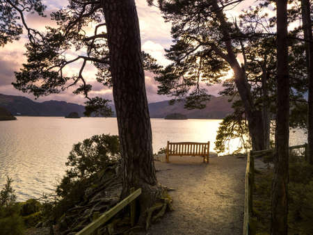 Deserted bench on the edge of Derwent Water Stock Photo - 17230236