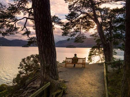 Woman sat enjoying the view across Derwent Water Stock Photo - 17230240