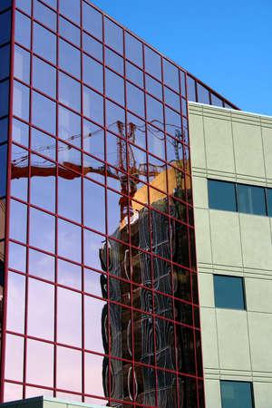 Crane reflecting in office window