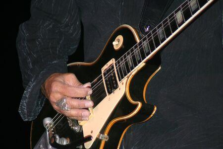 Rock and Roll Guitarist Picking Reklamní fotografie