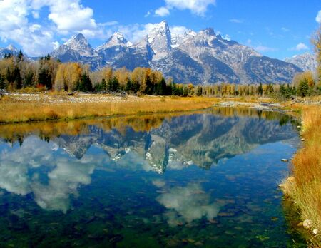 Tetons reflected in Snake River, Wyoming