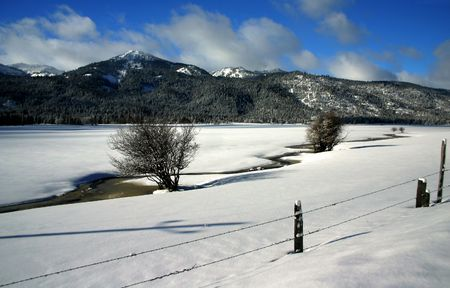 fenceline: View of West Central Mountains in winter, Valley County Idaho