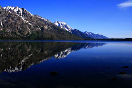 Early morning reflection on Jenny Lake, Grand Teton National Park, Wyoming