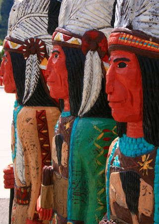 Wooden indians in front of cigar store