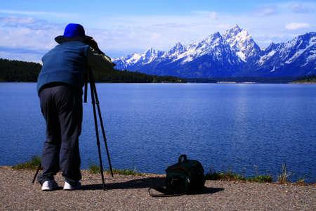 Photographer focused on his subject in Grand Teton