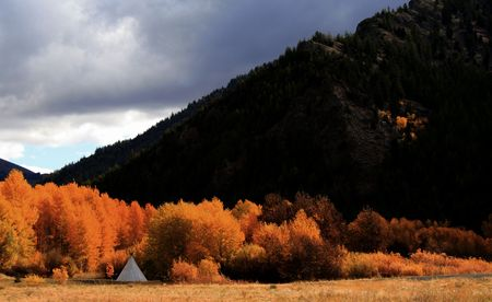 Tee-Pee tucked into the fall aspens, central Idaho