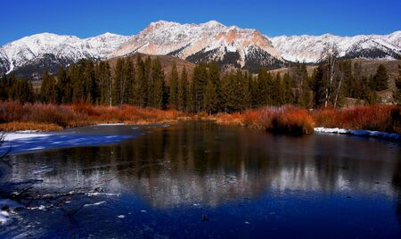 Big Wood River freezing over in places in early winter, Idaho Stock Photo