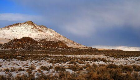 sagebrush: Winter storm passing over high desert mountains near Shoshone Idaho Stock Photo
