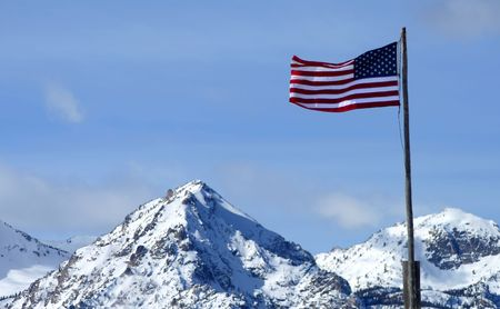 U.S. Flag with Sawtooth Mountains in background